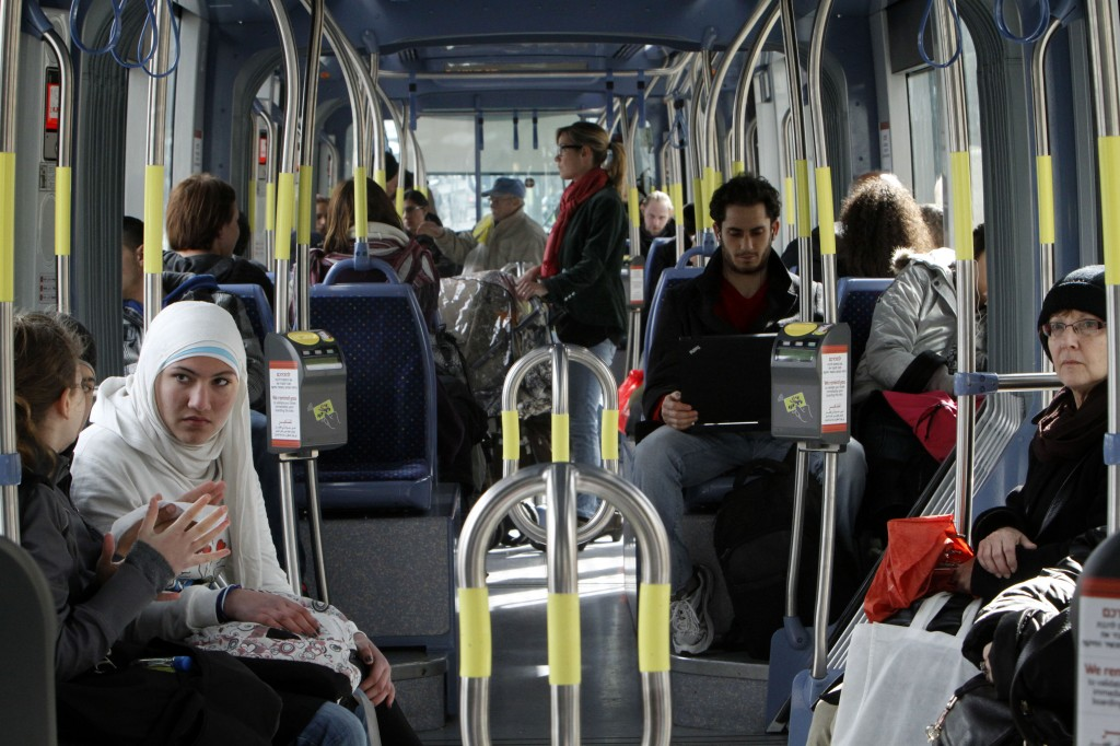 Jews and Arabs riding the Jerusalem Light Train (photo credit: Miriam Alster/Flash 90)