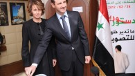 Syrian President Bashar Assad casts his ballot next to his wife Asma at a polling station during a recent referendum on the new constitution, in Damascus, Syria. Reports say shots were fired at Assad during a visit to Homs. (photo credit: AP Photo/SANA, File)