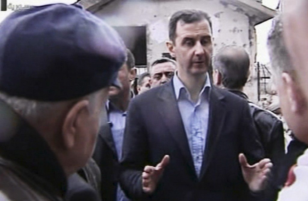 Syrian President Bashar Assad visits the Baba Amr neighborhood in Homs (photo credit: AP/Syrian State Television)