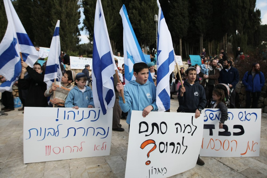 The settlers make a stronger case when they generate empathy for their agenda. Migron residents protest outside the Prime Minister's Office in February (photo credit: Kobi Gideon/Flash90)