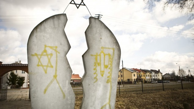 A monument found desecrated with anti-Semitic graffiti at a Jewish cemetery in Wysokie Mazowieckie, Poland (photo credit: AP/Jedrzej Wojnar)