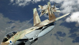 Two Israeli F-15I &#039;Ra&#039;am&#039; fighter jets during maneuvers. (photo credit: CC BY TSgt Kevin J. Gruenwald, USAF, Wikimedia)