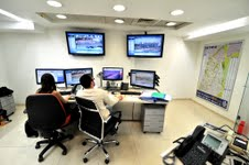 Staff at Ashdod's municipal control room, which aims to show residents that &quot;the routine is stronger than the state of emergency.&quot; (photo credit: David Katz, The Israel Project)
