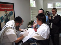 A bris ceremony, unrelated to the current metzitzah b'peh case.