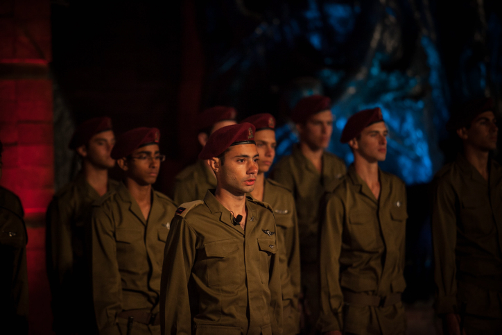 Israeli soldiers attend a ceremony at the Yad Vashem Holocaust Memorial in Jerusalem, Wednesday (photo credit: Noam Moskowitz/Flash90)