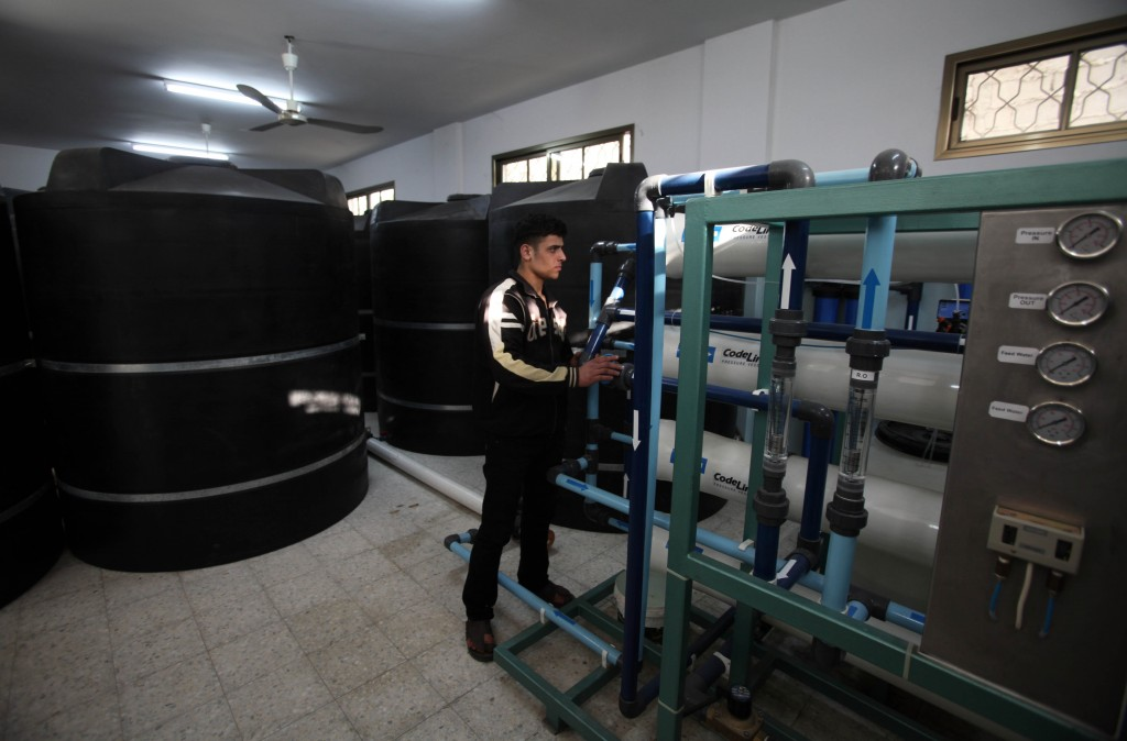 A Palestinian man works at a privately owned water desalination station in central Gaza Strip (photo credit: Wissam Nassar/Flash90)