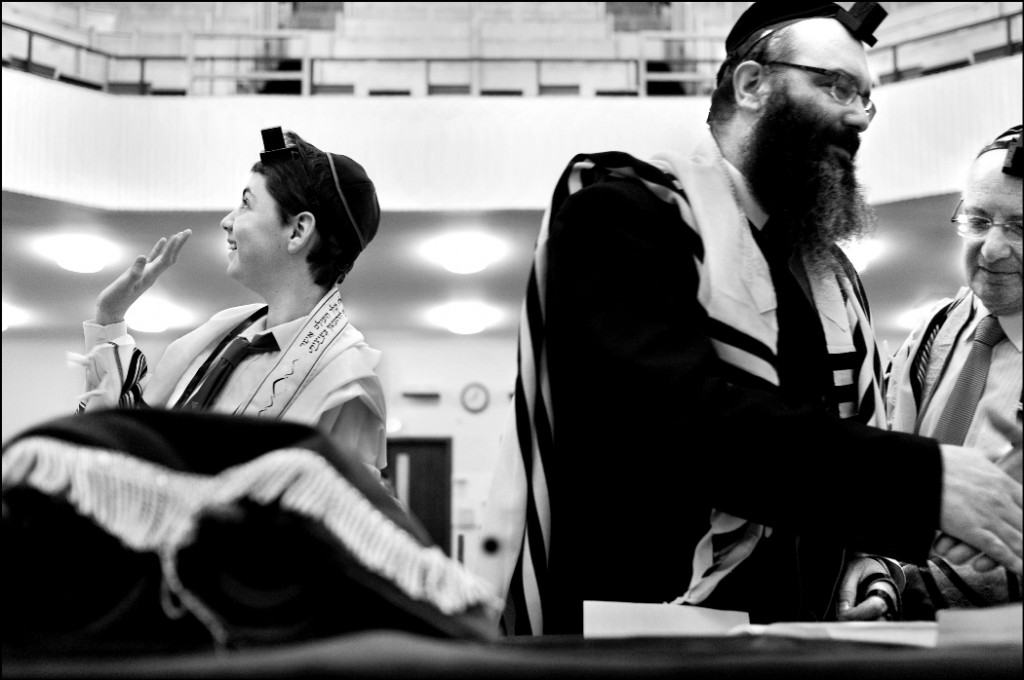 Glasgow 2010. A bar mitzva boy in an Orthodox synagogue waves to his mother who sits in the balcony. (photo credit: Judah Passow)