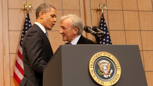 President Obama embraces Elie Wiesel before delivering a speech about the Holocaust and its meaning at the US Holocaust Memorial Museum, April 23, 2012. (photo credit: Courtesy USHMM/JTA)