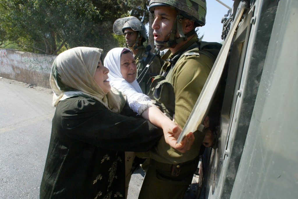 Emad's mother pleads with an Israeli soldier to release her son Khaled after he was arrested. (photo credit: Kino Lorber)