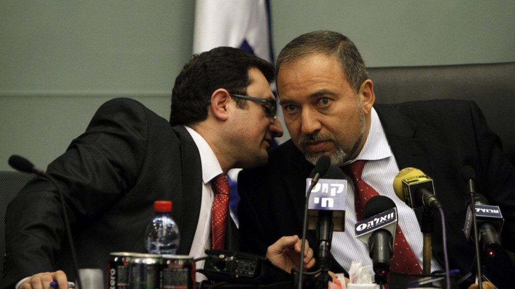 MK Robert Ilatov (left) speaks with Yisrael Beytenu head Avigdor Liberman during a party meeting at the Knesset (Miriam Alster/Flash90)