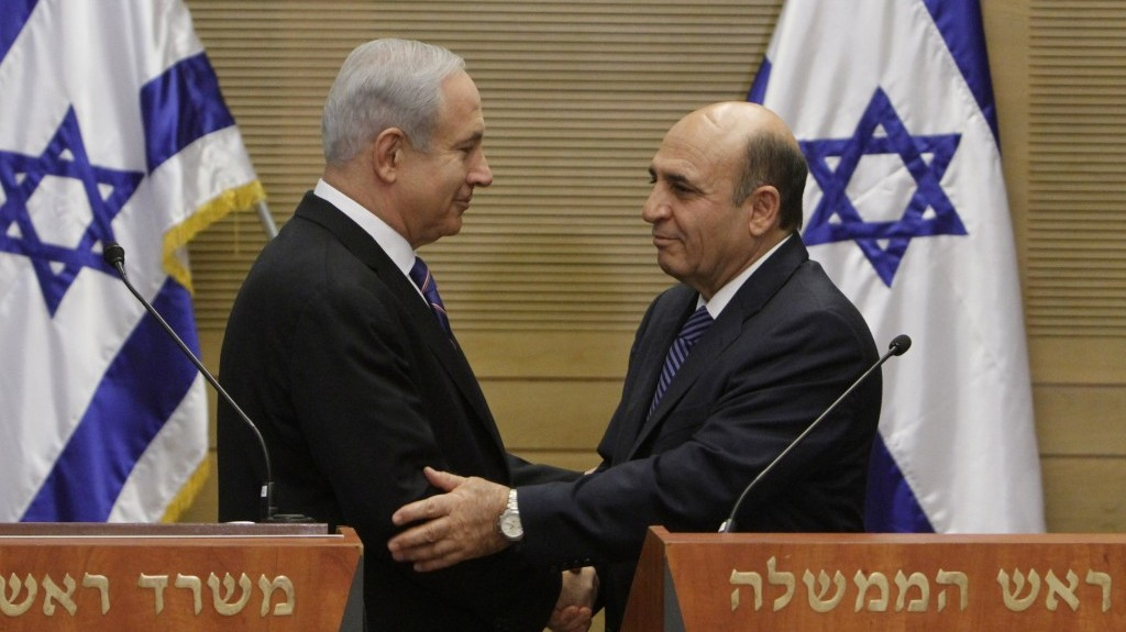 Prime Minister Benjamin Netanyahu, left, and Kadima chairman Shaul Mofaz deliver a joint press conference at the Knesset on May 8, announcing Kadima's entry into the governing coalition. For many pundits, entering the Netanyahu government was Mofaz's fatal mistake. (photo credit: Miriam Alster/Flash90)