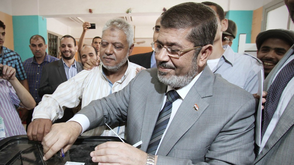 An 'inner circle' led by radical Islamists? Muslim Brotherhood Egyptian presidential candidate Mohammed Morsi casts his vote (photo credit: Ahmed Gomaa/AP)