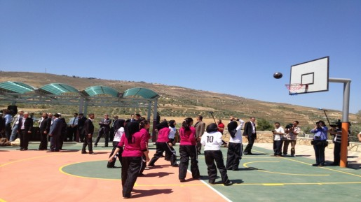Girls from the village of Burin, south of Nablus, inaugurating their school's brand new basketball court (photo credit: Raphael Ahren/The Times of Israel)