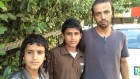 Oded (11), Azriel (14) and Yahya (36) Zandani, near Yahya&#039;s home in Rehovot, June 27 (photo credit: Elhanan Miller/Times of Israel)