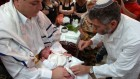 A rabbi performs a circumcision on an 8-day-old Jewish boy (illustrative photo: Max Yelinson/Flash90)