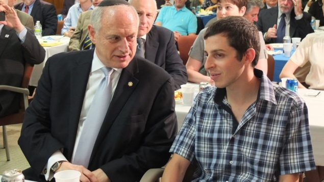 Malcolm Hoenlein (l.) of the Conference of Presidents speaks with released captive Gilad Shalit. Michael Datikash