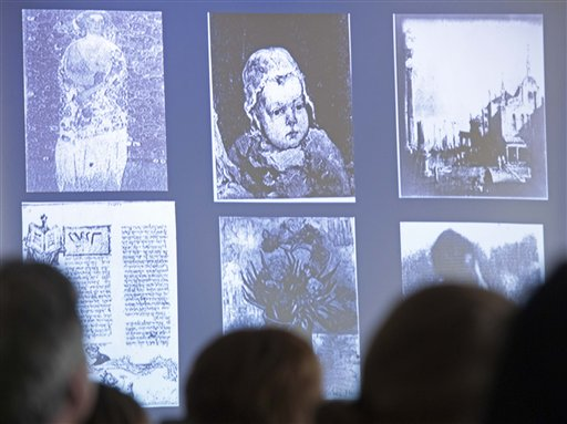 People look at a display of looted art on a video screen as they attend the Provenance Research Training Program to the Nazi-looted art, in Magdeburg, central Germany, Thursday, June 14, 2012. (photo: AP /Jens Meyer)