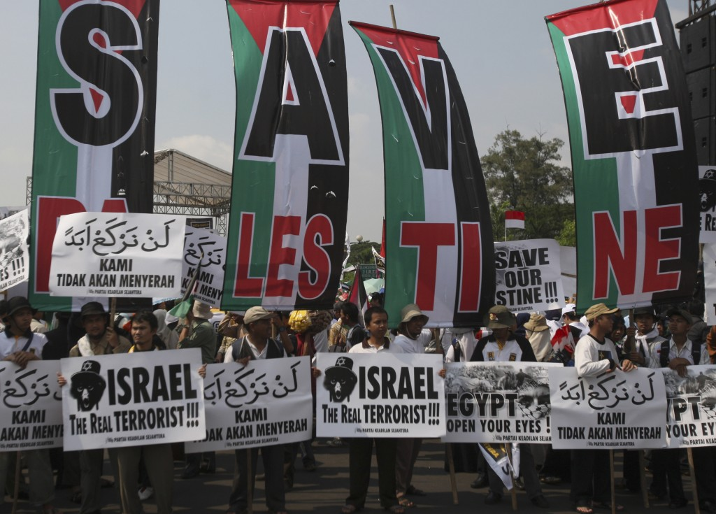 A growing ideological antipathy to Zionism. Muslim activists hold pro-Palestinian and anti-Israeli placards at a rally in Jakarta, Indonesia (photo credit: AP/Achmad Ibrahim)