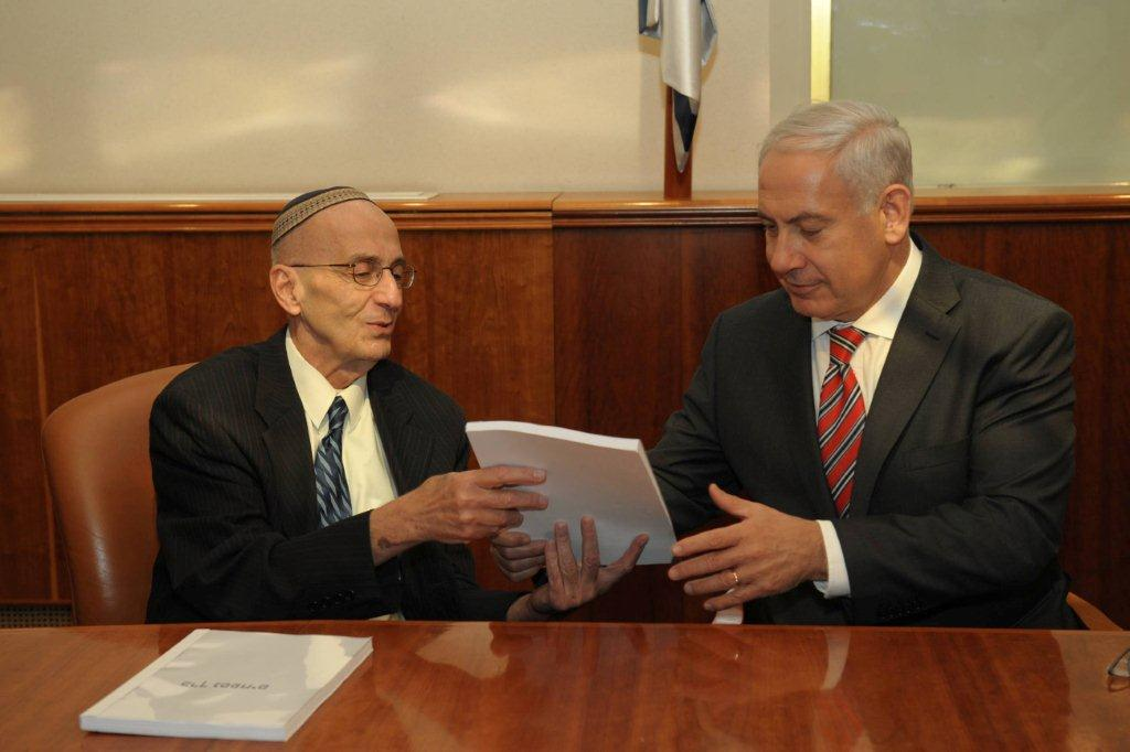 Edmond Levy (left) submits his committee's report to Benjamin Netanyahu last month (photo credit: Flash90)