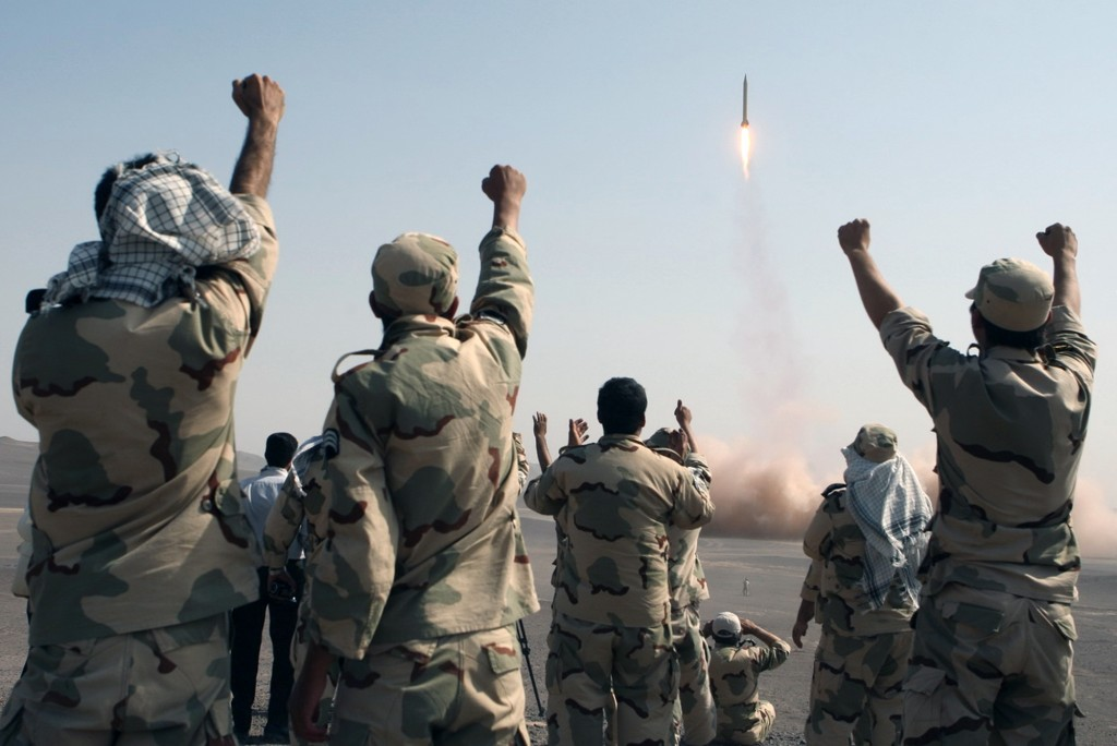 Members of the Iranian Revolutionary Guard celebrate after launching a missile, July 2012 (photo credit: AP/IRNA, Mostafa Qotbi)