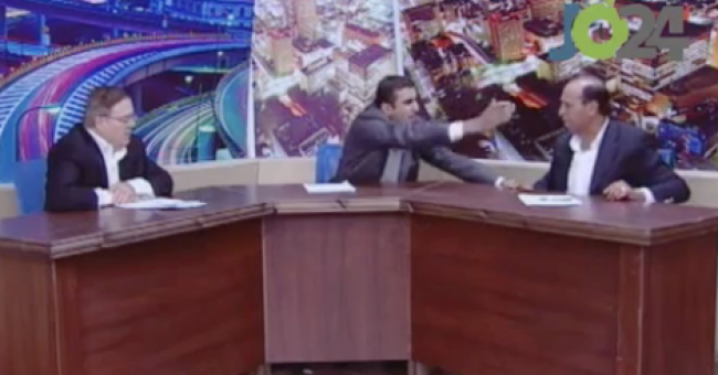 A heated debate on Jordan TV between an MP (right) and an activist (left) deteriorated into a brawl in which a gun was drawn. (photo credit: YouTube screen capture)