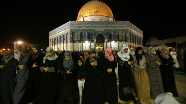 Muslim women pray near Al-Aqsa mosque, August 8 (photo credit: Mahfouz Abu Turk/FLASH90)