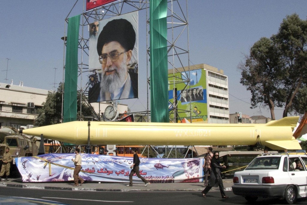 'Incitement is the terrifying and vilifying context in which Iran's nuclear weaponization is being accelerated.' A military exhibition displays a Shahab-3 missile under a picture of Iranian supreme leader Ayatollah Ali Khamenei (photo credit: AP photo/Hasan Sarbakhshian)