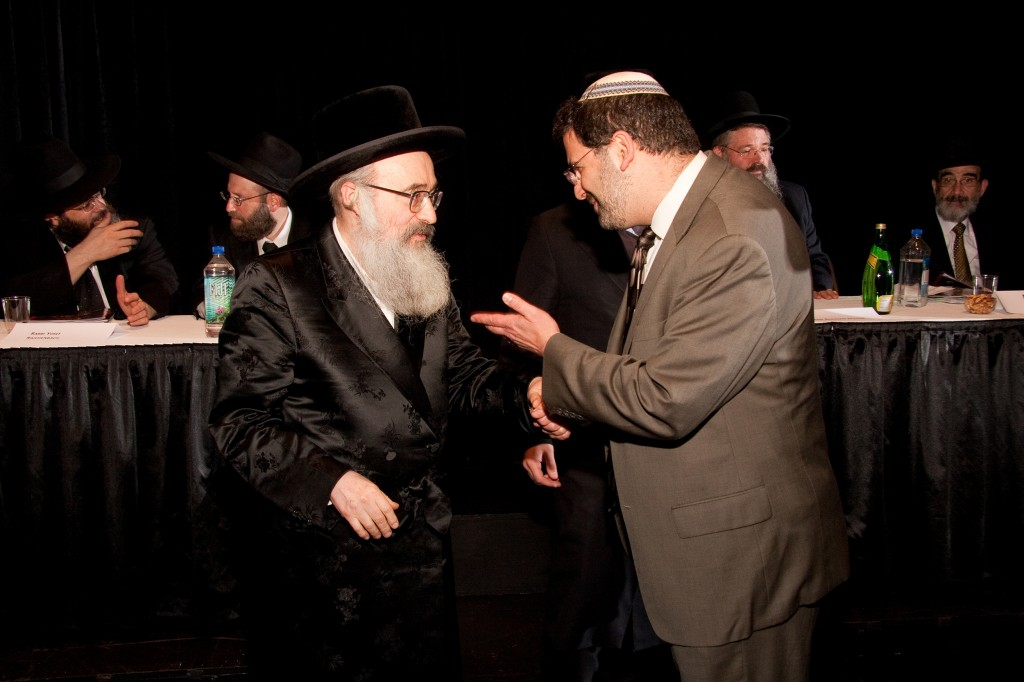 Rabbi Asher Lopatin, right, the incoming president of the Modern Orthodox Yeshivat Chovevei Torah, confers with Rabbi Yehoshua Eichenstein, the Zidichiver rebbe, at Chicago's Siyum HaShas celebration. (photo credit: Fred Eckhouse Photography/JTA)