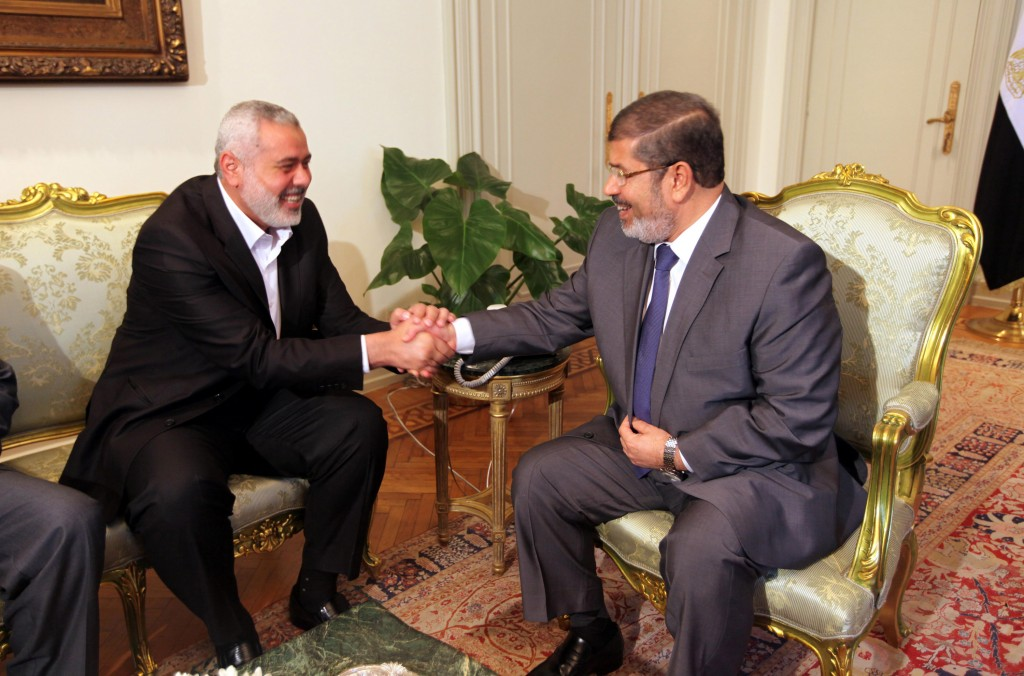 Hamas PM Ismail Haniyeh (left) during a meeting with Egyptian president Mohammed Morsi in Cairo, July 26 (photo credit: Mohammed al-Ostaz/Flash 90)
