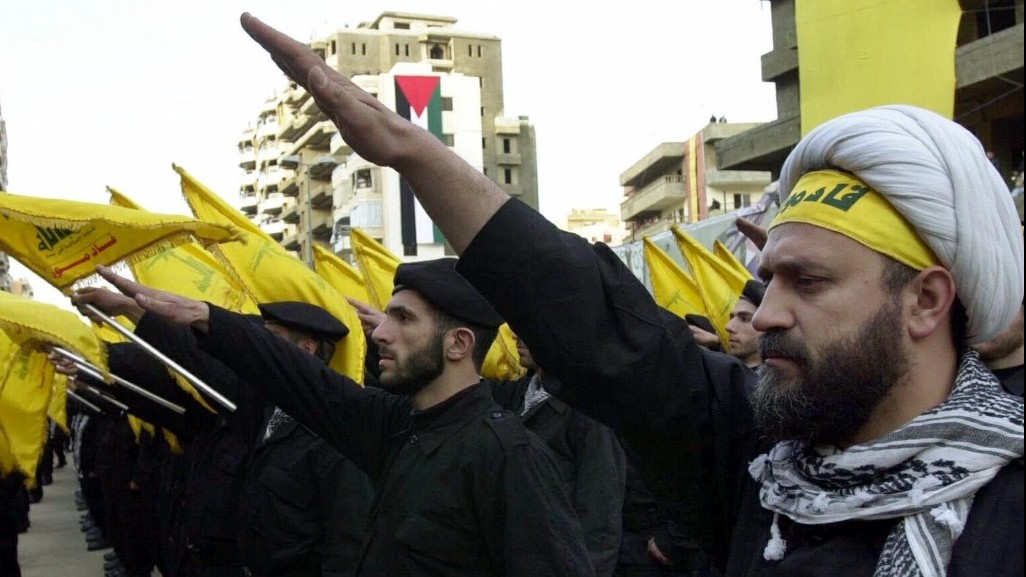 Hezbollah fighters take an oath to continue the path of resistance against Israel during a parade in 2000. (photo credit: AP/Hussein Malla)