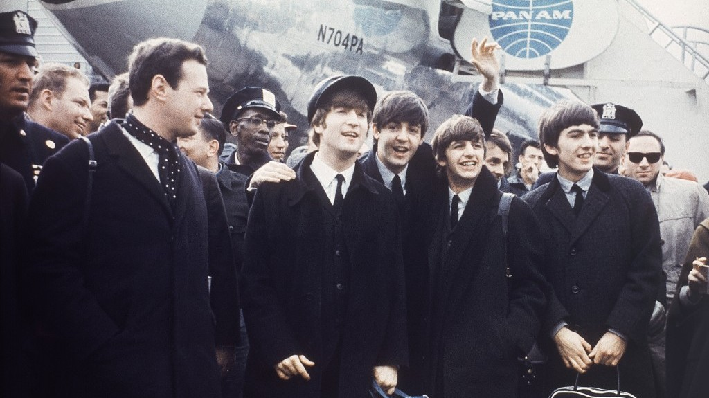 Brian Epstein (left) with The Beatles on tour in 1964. (photo credit: AP Photo)