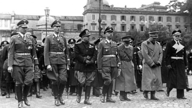 German and Italian brass in Rome, 1940. From left to right: Karl Wolff, Reinhard Heydrich, (unknown), Heinrich Himmler, Emilio de Bono, Rodolfo Graziani, and Hans Georg von Mackensen. (photo credit: CC BY-SA  Bundesarchiv, Bild 121-2051, Wikimedia Common)