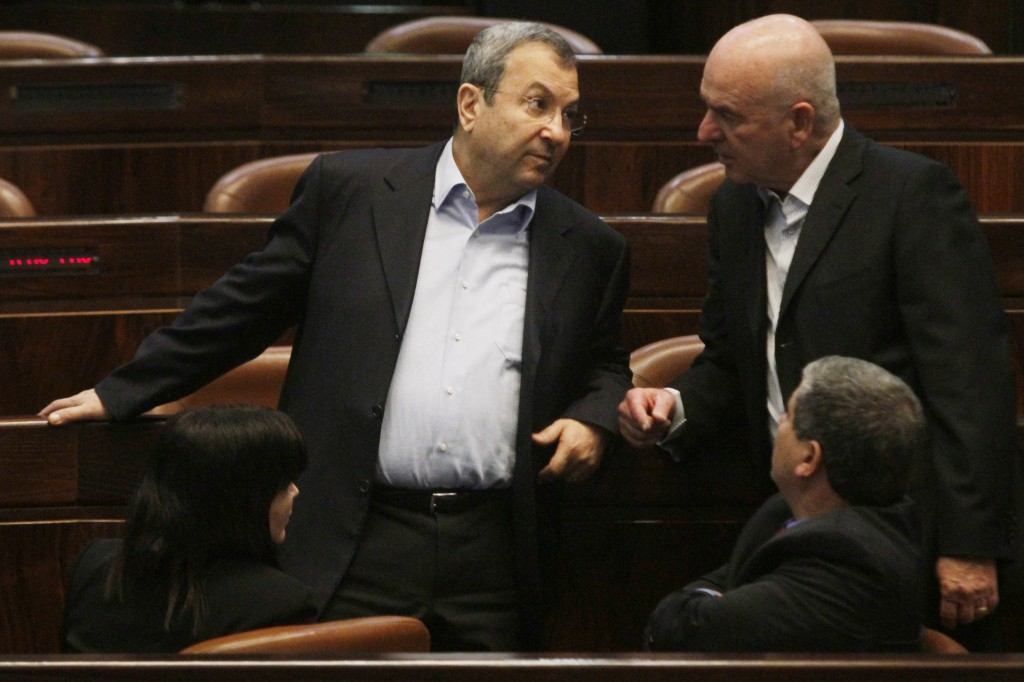 Are they discussing their political future? Ehud Barak chatting with fellow Atzmaut party members last year. (photo credit: Uri Lenz/Flash90)