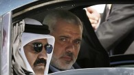 Qatari Emir Sheikh Hamad bin Khalifa al-Thani, left, and Gaza&#039;s Hamas prime minister Ismail Haniyeh, right, arrive for a cornerstone laying ceremony for Hamad, a new residential neighborhood in Khan Younis, southern Gaza Strip, October 23 (photo credit: AP/Mohammed Salem)