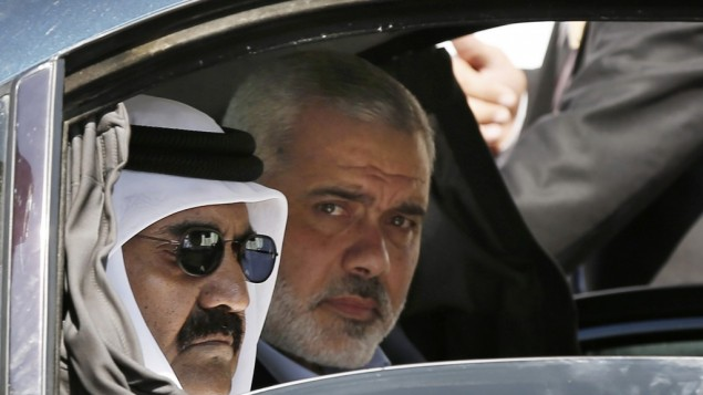 Qatari Emir Sheikh Hamad bin Khalifa al-Thani, left, and Gaza's Hamas prime minister Ismail Haniyeh, right, arrive for a cornerstone laying ceremony for Hamad, a new residential neighborhood in Khan Younis, southern Gaza Strip, October 23, 2012 (photo credit: AP/Moh