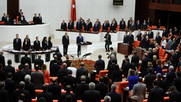 Turkish lawmakers and ministers  at Turkey's parliament in Ankara (photo credit: AP