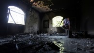 A Libyan man investigates the inside of the US Consulate, after an attack that killed four Americans, including Ambassador Chris Stevens on the night of Tuesday, Sept. 11, 2012, in Benghazi, Libya (photo credit: AP/Mohammad Hannon)