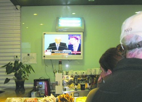 The scene at the Aroma Café in Jerusalem as Prime Minister Netanyahu announces early elections. Michele Chabin