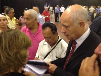 Minister Michael Eitan signing up Likud members opposing the joint list with Yisrael Beytenu, Tel Aviv, October 20, 2012. (photo credit: Raphael Ahren/Times of Israel)