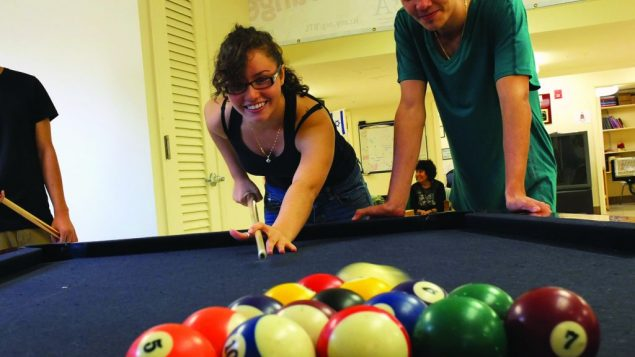 Pool and other games at the Bukharian Teen Lounge keep teens off the streets. Michael Datikash