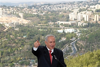 Netanyahu speaking in front of the Jewish east Jerusalem settlement of Gilo. Getty Images