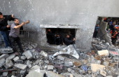 Palestinians search the debris of the al-Dallu family home after an Israeli airstrike on Nov. 18. Getty Images