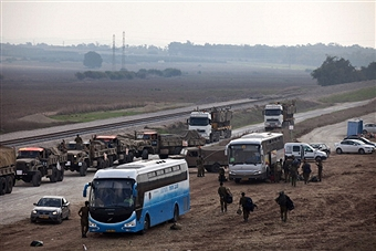 Israeli reserve soldiers leave the Gaza border on Nov. 22. Getty Images