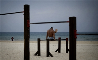 A man works out on the beach in Ashdod on Nov. 22, a day after the cease fire was declared. Getty Images