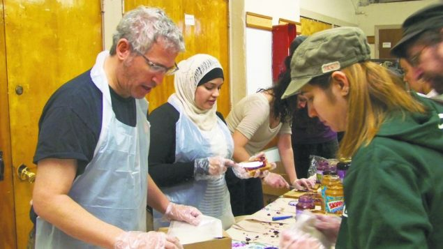 Jewish and Muslim volunteers prepare packages of food at St. Mary's Episcopal Church on the Upper West Side. Photos by Tatyana R