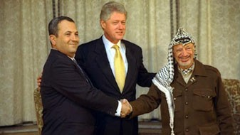 Ehud Barak, left, with Bill Clinton and Yasser Arafat (photo credit: Sharon Farmer)