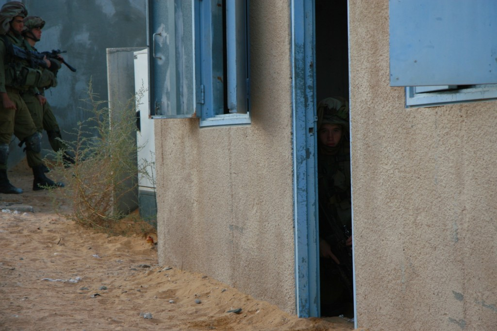 A soldier pretending to be an enemy in a mock house meant to simulate the Gaza Strip (Photo credit: Alon)
