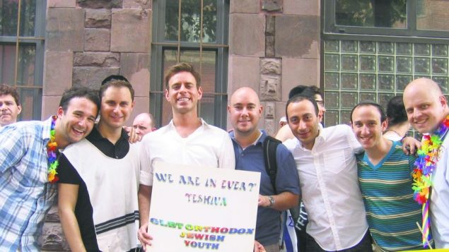 "Members of JQY, a support and social group for religious, gay Jews, gather for one of their ""pride picnics."" Courtesy of JQY"