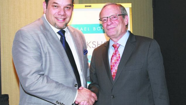 National Hispanic Christian Leadership Council's Rev. Carlos Ortiz, left, with Israel Bonds' CEO Israel Tapoohi. David Karp