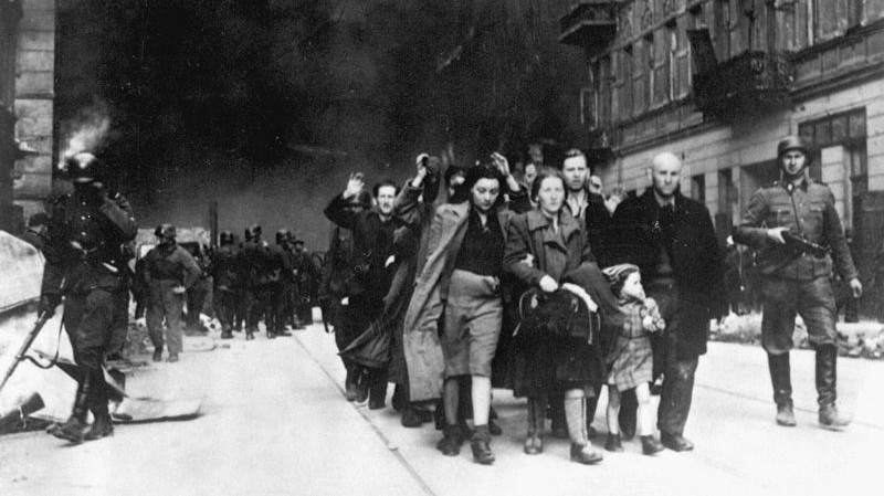 Jews in the Warsaw Ghetto are led by German soldiers to an assembly point for deportation to death camps, 1943. (photo credit: public domain)